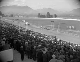 [Crowd watching horse race at Hastings Park]
