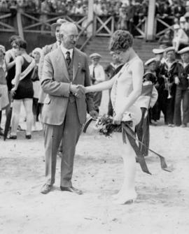 [Mayor L.D. Taylor, judge, with Miss Pantages, contestant in the Jantzen Knitting Mills Bathing B...