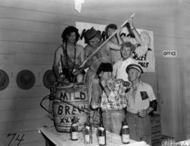 "Men dressed as characters from Li'l Abner comic strip with ""Kickapoo Joy Juice"""