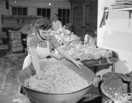 [Woman mixing ingredients at] Dale's [Roast Chicken] kitchen on Granville Street
