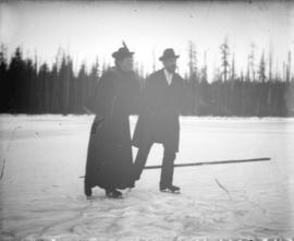 [Man and woman skating on Trout Lake]