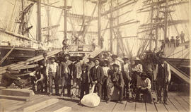 [William Nahanee with a group of longshoremen on the dock of  Moodyville Sawmill]