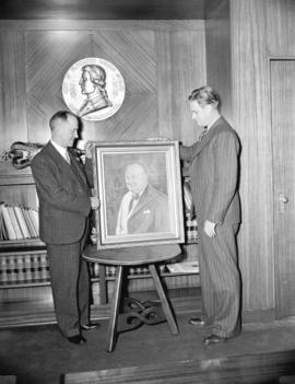 Hal Denton and Mayor Cornett [with portrait of Winston Churchill outside Council Chamber at City ...
