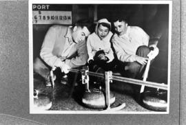 Three people curling