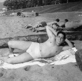 Man sunbathing on beach