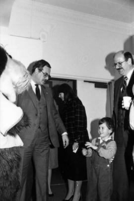 Mike Harcourt and child with group of unidentified men