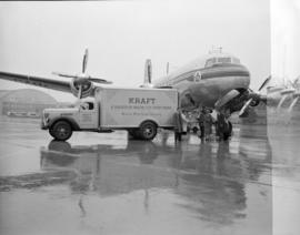 [Kraft Foods Limited truck parked beside a TCA airplane]