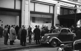 [People gathered outside Hudson's Bay Co. store]