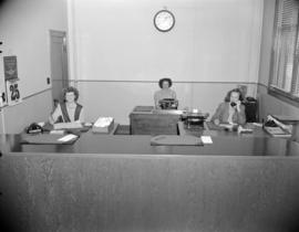 [B.C. Telephone reception counter and employees]