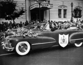 Decorated car carrying dignitaries, including B.C. Premier B. Johnson, in 1949 P.N.E. Opening Day...