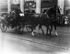 [Mayor L.D. Taylor in horsedrawn carriage with Col. Duffus, head of the Northwest Mounted Police ...