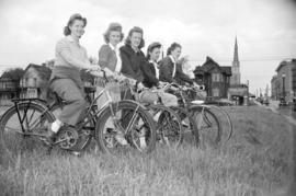 [Women on bicycles in a field, taken for Canadian Youth Hostels]