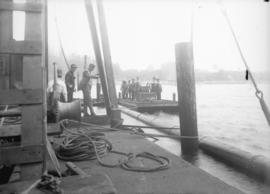 [Pipeline and dock with work crew]