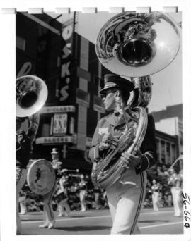 Member in Bellingham High School marching band holding Sousaphone in 1956 P.N.E. Opening Day Parade