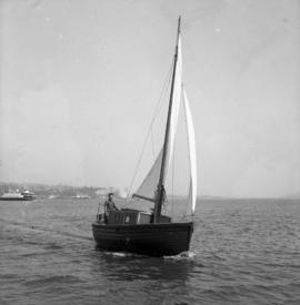 Koenig on sailboat, a converted lifeboat with leeboards