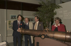 Gordon Campbell and group beside canon at Legacies Program event at The Bay