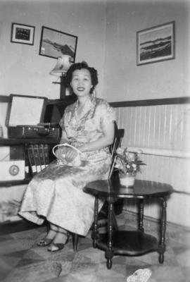Woman seated in living room of house