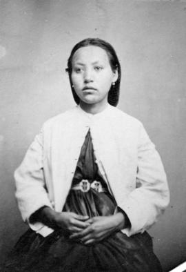 [Studio portrait of unidentified First Nations Woman in European-style clothing]