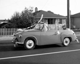 [A Morley Smith Motors Limited convertable in a parade along West Boulevard to celebrate the begi...