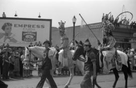 [Chinese in Chinese opera costume on horses in the Vancouver Golden Jubilee parade]