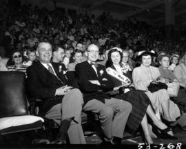 P.N.E. directors and Miss P.N.E., Lynn Adcock, watching show