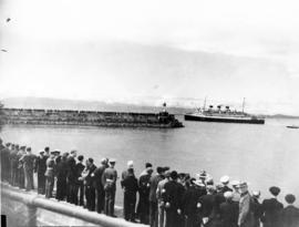 "[People line the waterfont to watch the S.S. ""Prince Robert"" leaving Victoria after the..."