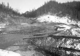 [Partially constructed Coquitlam Dam, looking northeast toward borrow pit]