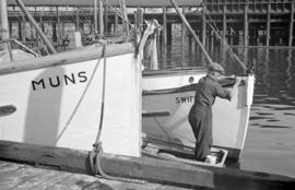 [Man painting boat]