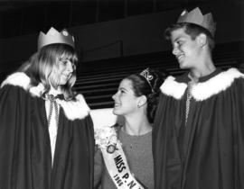 Judy Collyer, Miss P.N.E. 1966, poses with two children in costume