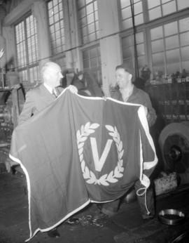 Presentation of [Victory] flag [at Granville Island]