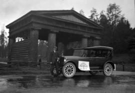 """Reo Six"" [automobile] leaving Vancouver for New Brunswick at Lumberman's Arch"