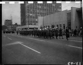 Women in uniform marching in 1959 P.N.E. Opening Day Parade