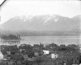 [View of West End buildings, Burrard Inlet and North Shore mountains, looking north from roof of ...