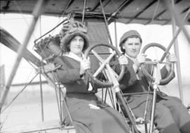 [Mr. and Mrs. William McIntosh Stark behind wheels of Curtiss School airplane]