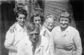Four female workers with man in lab coat