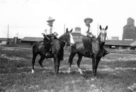 Mayor L.D. Taylor on horseback in cowboy hat, with friend Gale