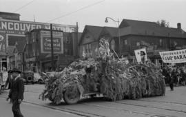 [A float covered in cedar boughs during a Chinese parade during VJ Day celebrations]
