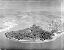 [Aerial view looking east over Stanley Park, Coal Harbour and Burrard Inlet]