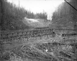 [Partially constructed Coquitlam Dam, showing trestle supported flumes in foreground and hydrauli...