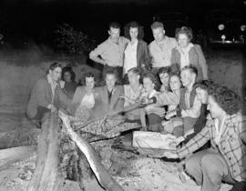 [Group of B.C. Telephone employees at a beach bonfire social event]