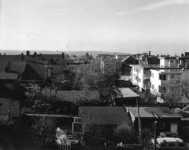[View looking west showing the back yards of houses and apartments in the 2100 block and 2200 blo...