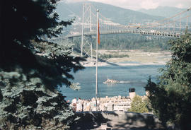 [View of a ship and tugboat passing under the Lions Gate Bridge from Prospect Point]