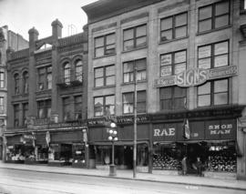[Stores on the northside of Hastings Street between Cambie and Abbott Streets]