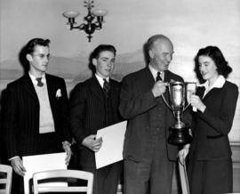 J.S.C. Moffitt presenting trophy to young woman