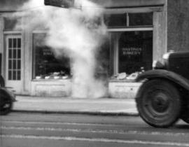 [A tear-gas bomb in the doorway of Hastings Bakery during the Powell Street Riot]
