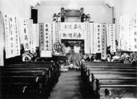 [Inside of church showing Yip Sang's casket]
