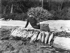 [Fisher with salmon catch at Bargain Harbour]