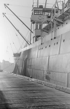 "[The side of the ""Kobe Maru"" at dock]"