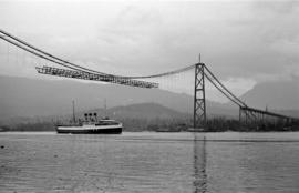 [Ship passing under the Lions Gate Bridge under construction]