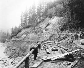 [Men clearing road after Seymour creek washout]